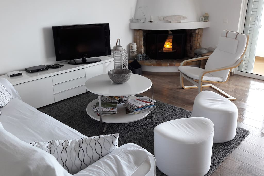 Elegant all white furniture and wooden floors