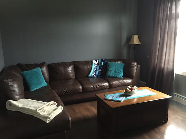 TV Room on Main floor. Equipped with smart TV and fireplace