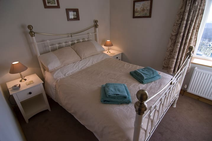 Really comfy bed, large duvet and blanket if required. Hairdryer and alarm clock. Beautiful views across to Longnor Woods.