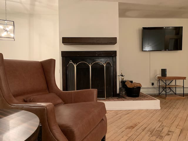 Armchair and Working Fireplace