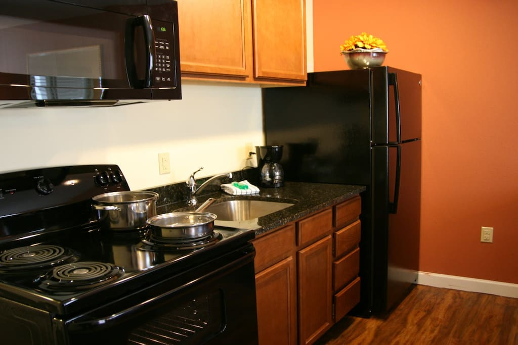 Full kitchen.  Basic cookware and dishware for 2