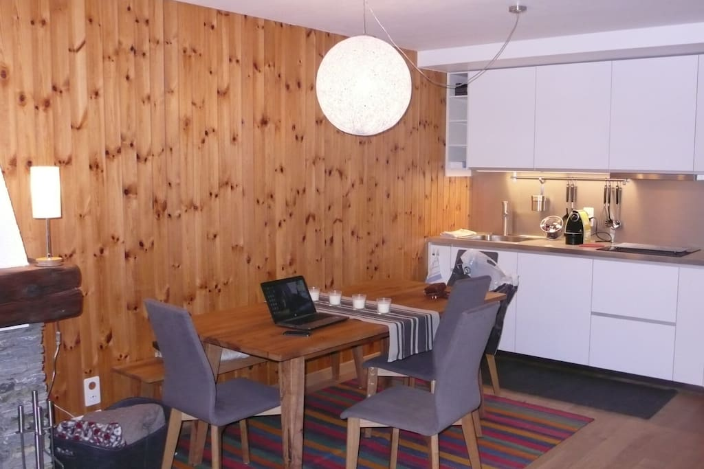 Large wooden table,  chairs and bench for a comfy dining room. Fully equipped modern kitchen with all facilities. Wooden floors throughout.