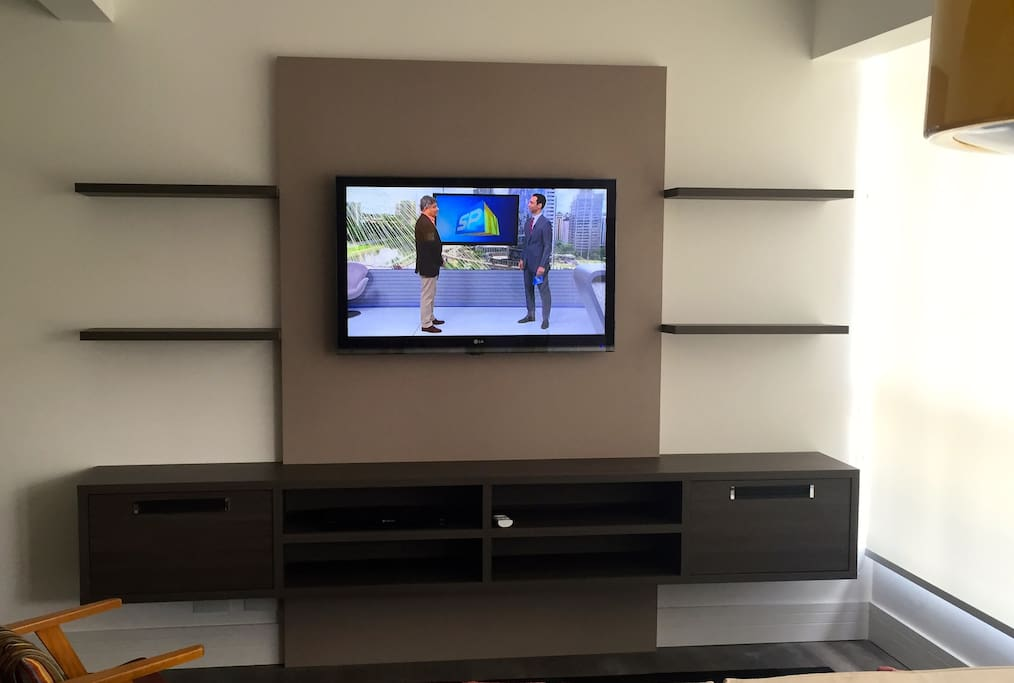 Flat Digital TV and DVD player into a modern furniture.