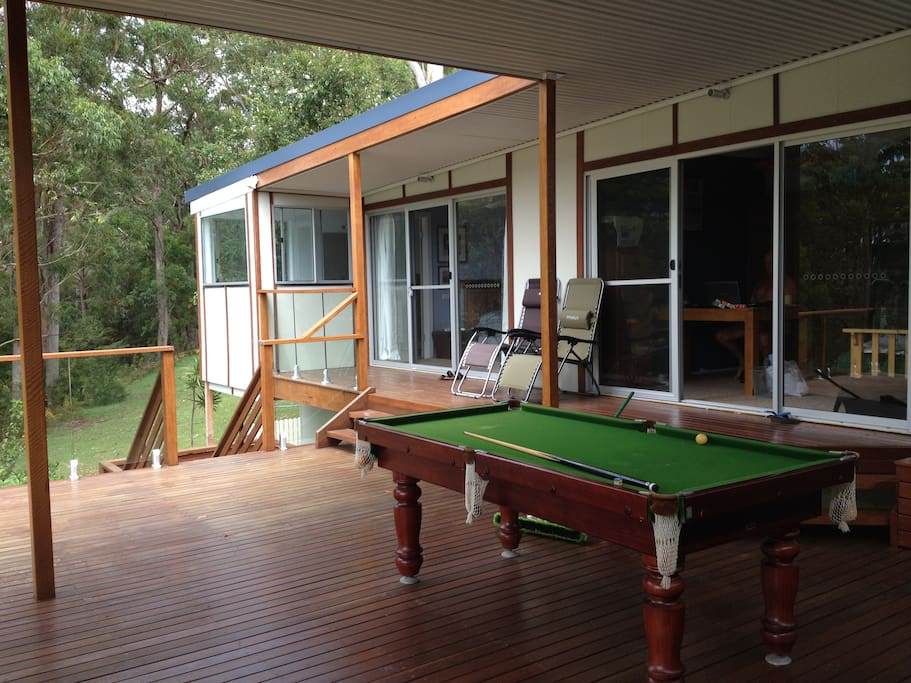 Lounge and two bedrooms open onto the deck for dining, relaxing and pool playing