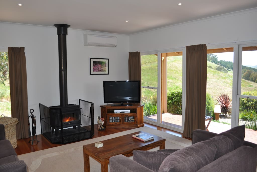 Cosy wood fire for the cooler months keeps the whole cottage warm.