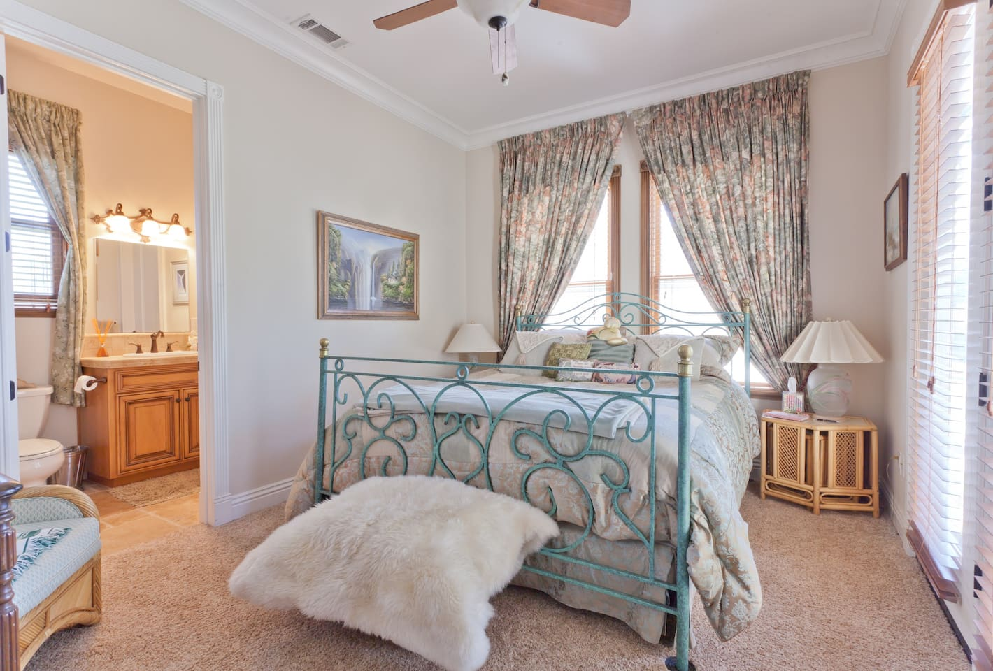 Spacious room, lots of light.  California King Size bed, down comforters and pillows.  Both a private bath and a private entry.