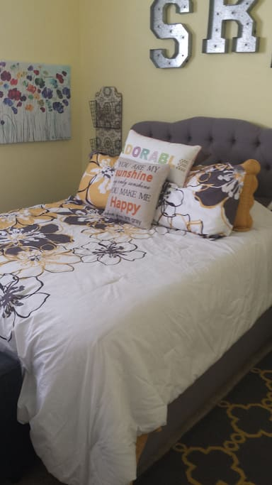 Guest bedroom with queen bed in the house