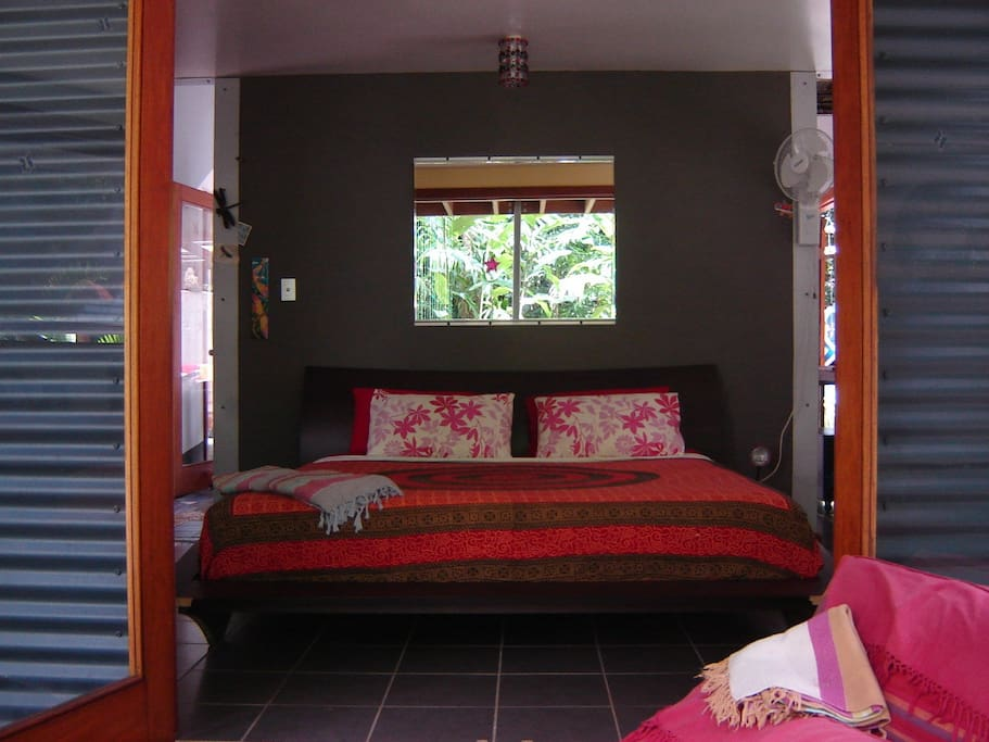 The master bedroom has a king size bed and verandah looking out onto the forest so that you wake up to stunning views every morning