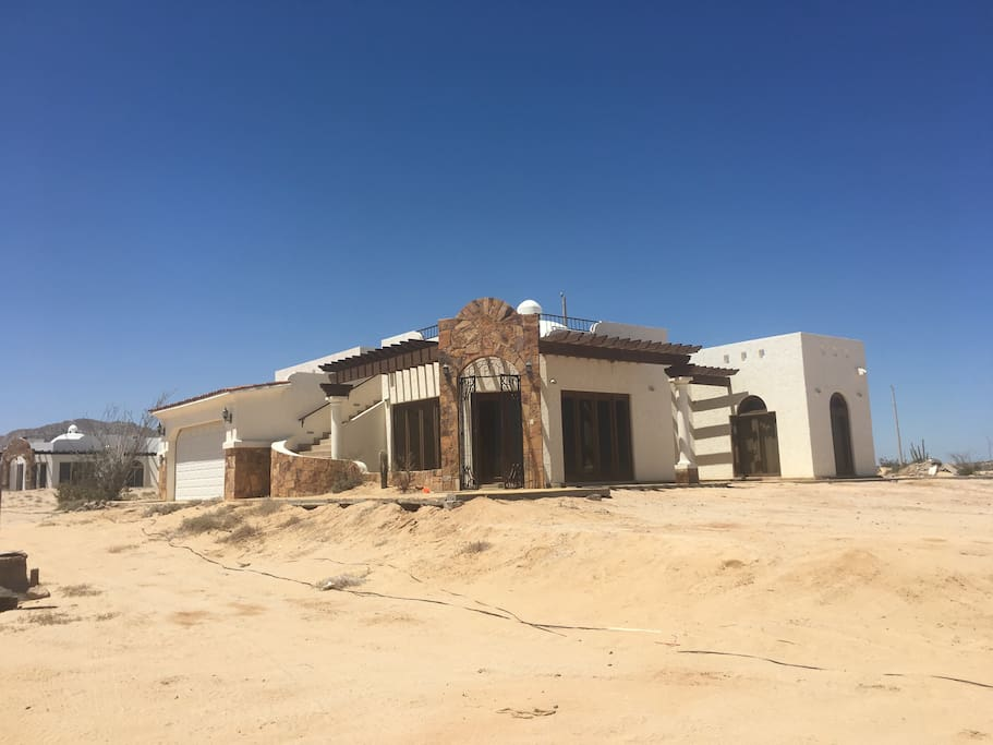 Three bedroom, two full bathrooms, and 2 car garage just 12 miles south of San Felipe. Plenty of parking for your cars trucks and toys in the front and the back of the house