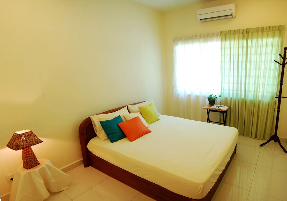 Air-conditioned bed-room with fan and attached bathroom