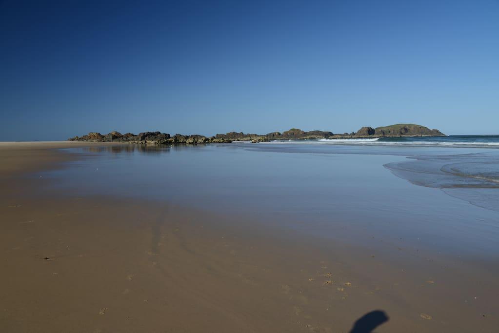 View along the beach toward Delicate Nobby