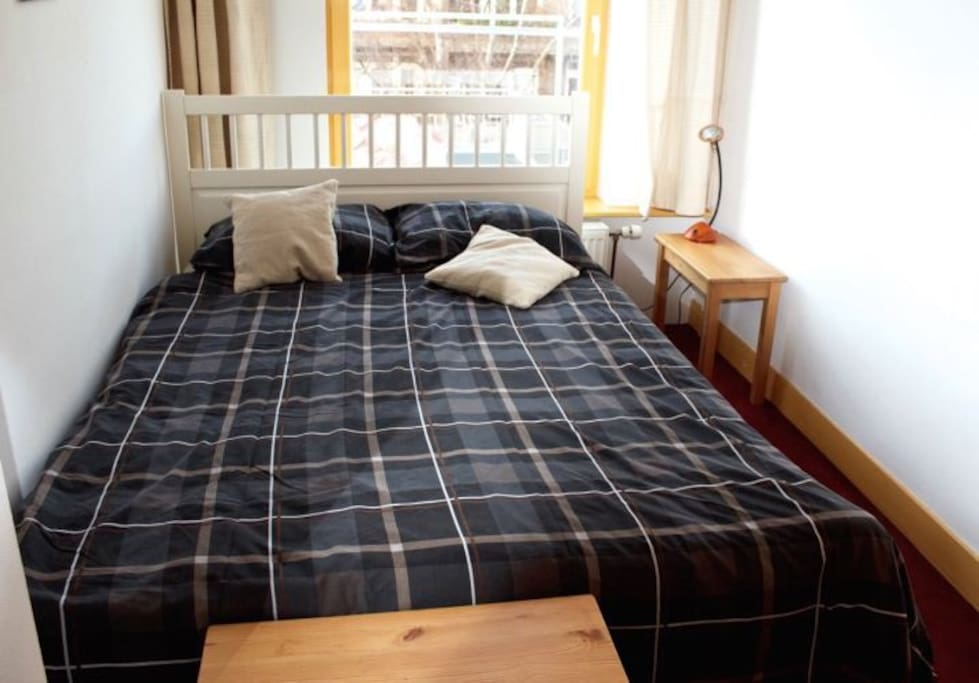 very light bedroom with double bed