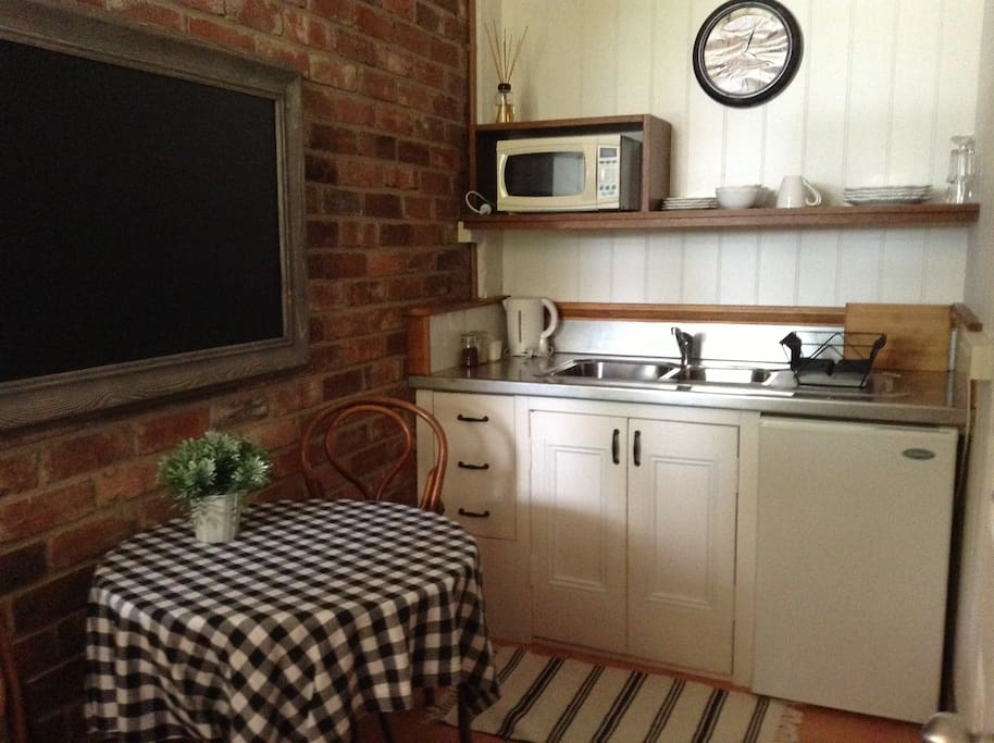 Kitchenette with toaster, kettle, tea & coffee, microwave  etc