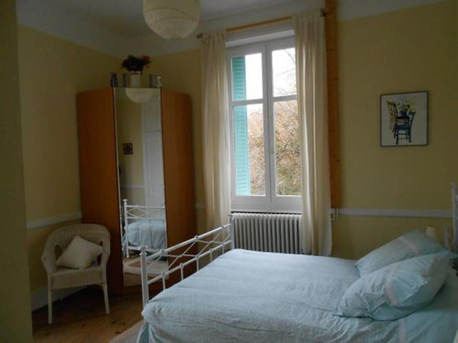 Spacious room with en suite shower room overlooking open countryside and private garden.