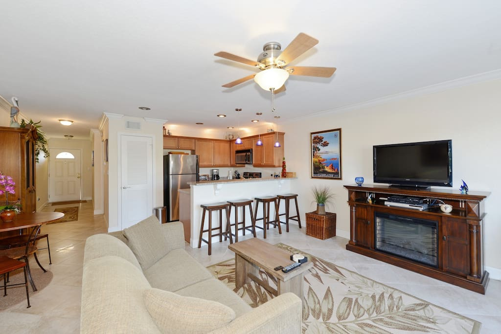 Enjoy the flat screen TV with cable box and a lovely indoor fireplace.