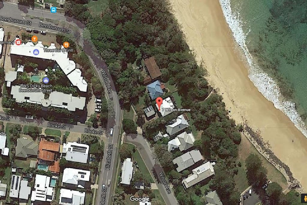 Ariel view showing Trentham House location on the foreshore of Dicky Beach at the end of the Wilson street so no passing traffic.