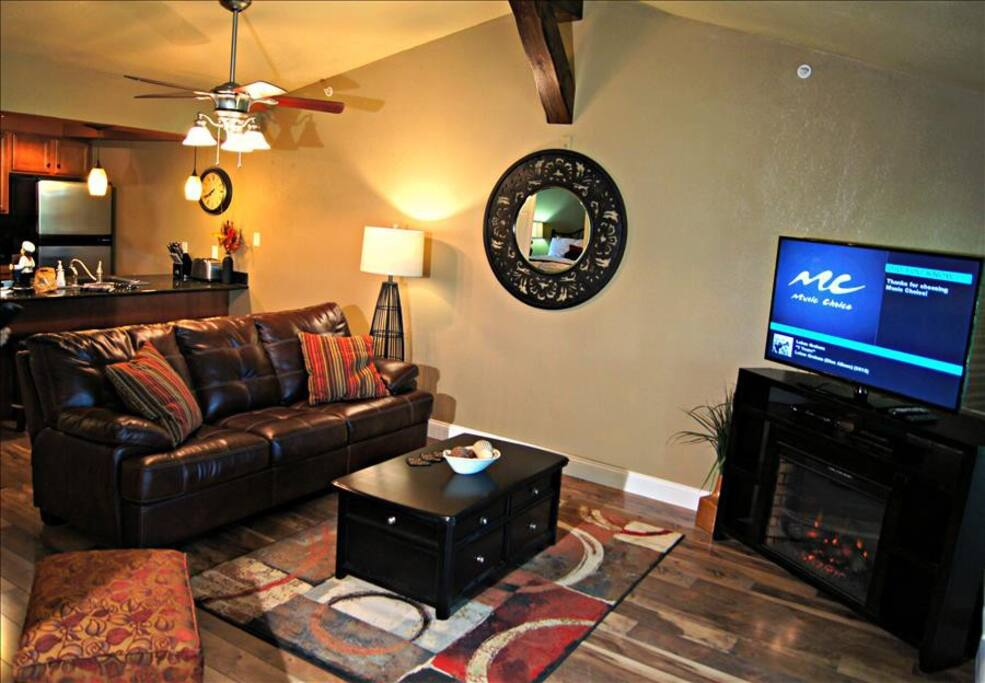 """Living Area with 55"""" HDTV and Fireplace"""