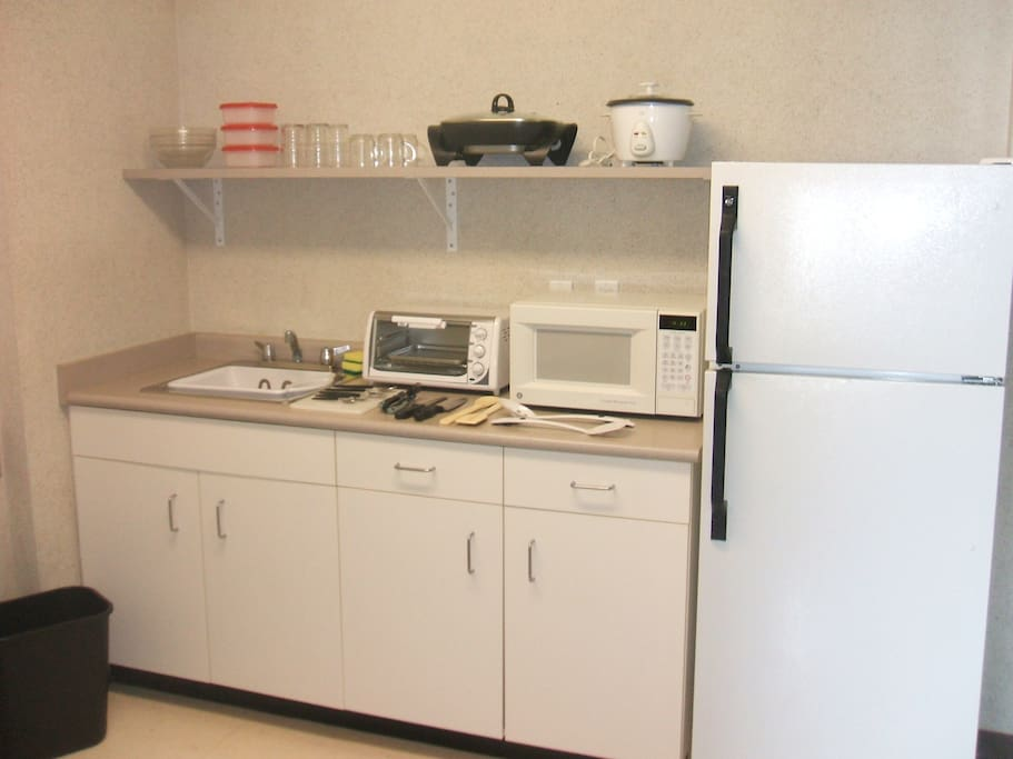 Dishes, cutlery, and small appliances included