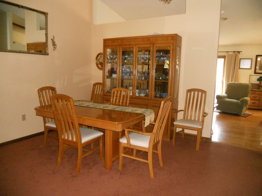 Large Dining table with view of Family Room and sliders to deck & pool