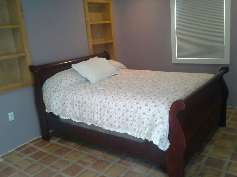 Back bedroom has queen size bed. Also new mattress, pillows, and linen.