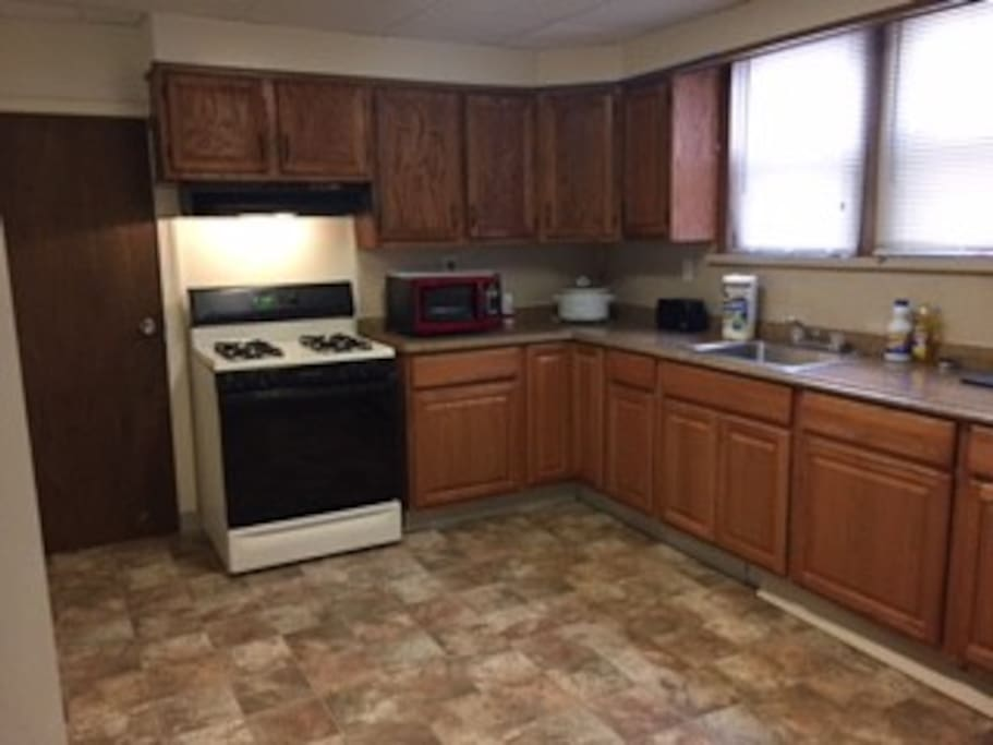 Full-size kitchen included is gas cooking microwave refrigerator and access to cooking utensils
