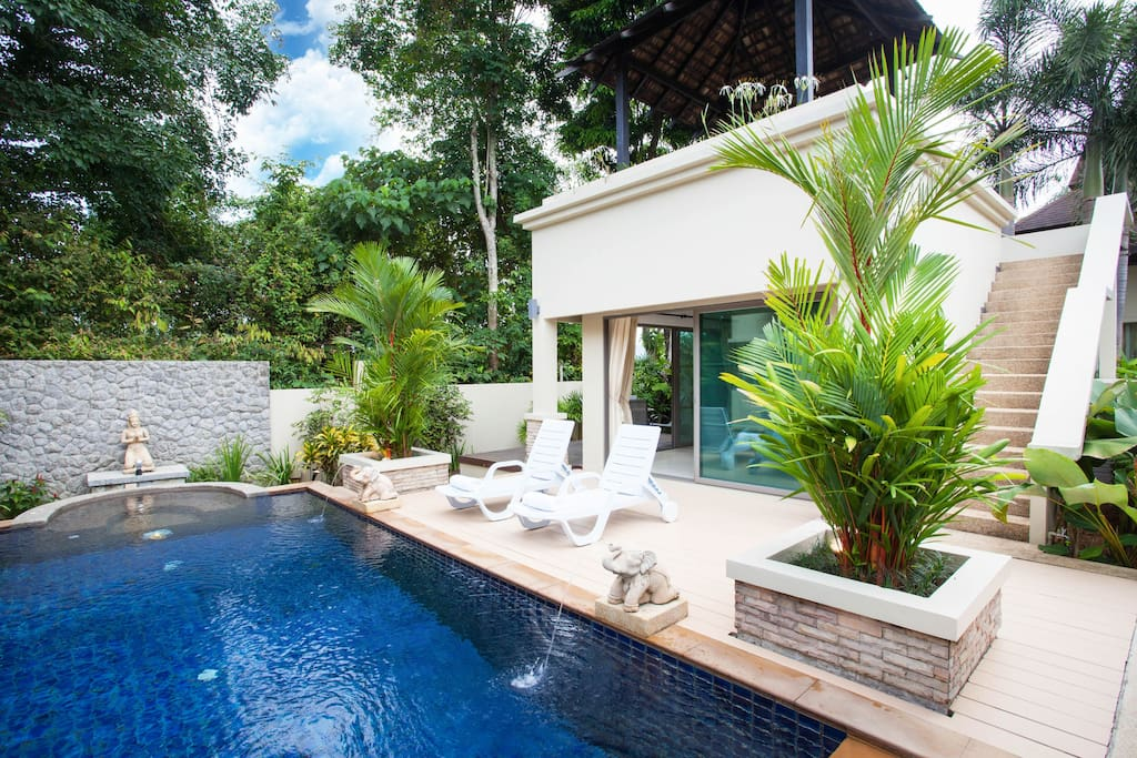 Tranquillity of the pool set against lush trees