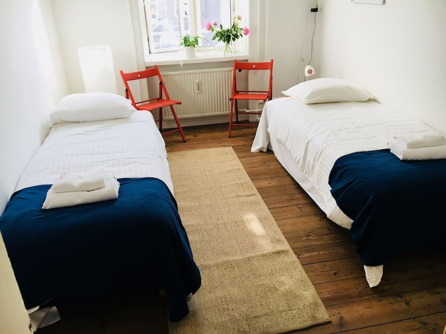 Bedroom 2: a medium size room with twin beds (can be pushed together to make a double), overlooking the vibrant Copenhagen street