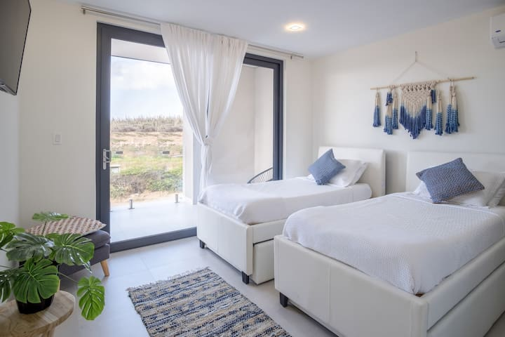 Bedroom with two beds and air conditioning