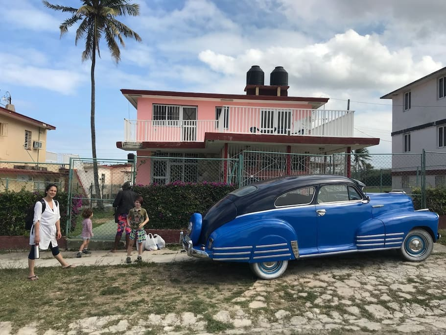 Some guests arriving at our 50's modernist style home. It could be you!  All the rooms have been refurbished and are clean and bright. Notice the sun terrace on the 1st floor.