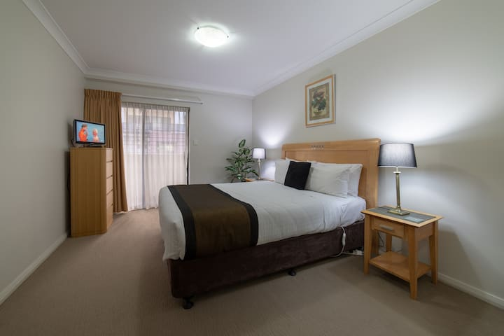 Bedroom with comfortable Queen size bed and electric blanket and second tv.