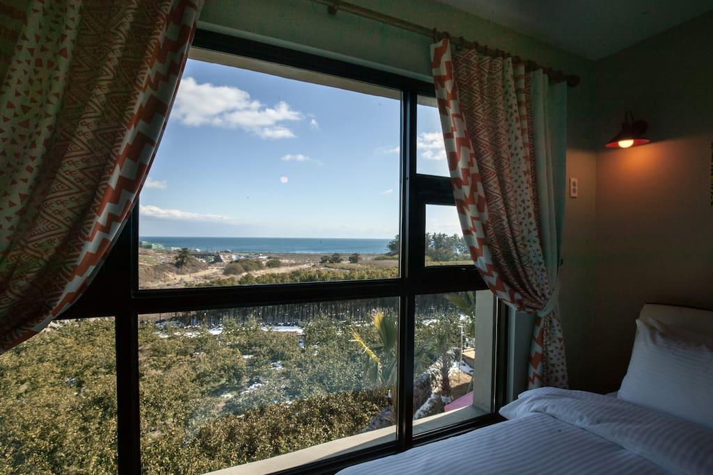 Living room with a fantastic view of ocean beyond 3x2meters huge window