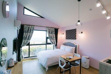 Living room with a fantastic view of ocean beyond 3x2meters huge window at 5meters height ceiling