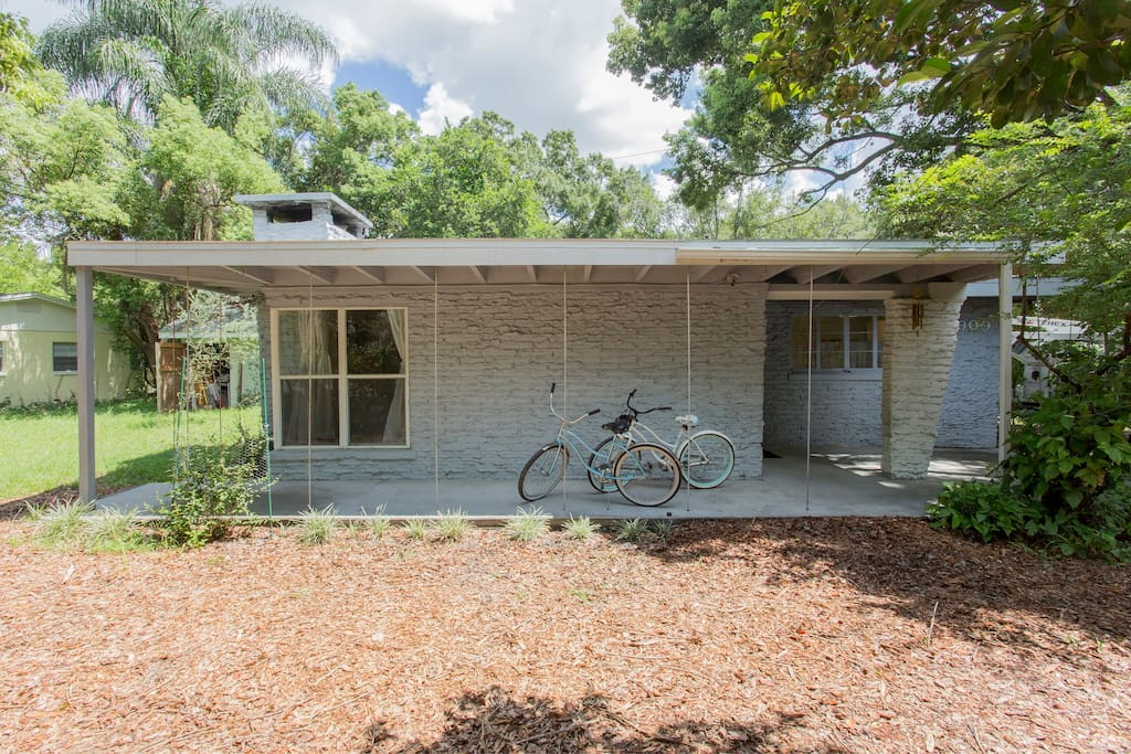 Restored mid century home, landscaped for privacy from the street, a block from major east- west street.