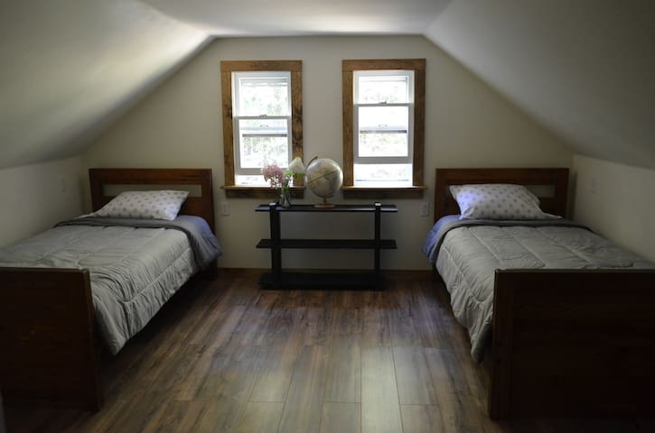 Upstairs bedroom with two twin size memory foam mattresses.