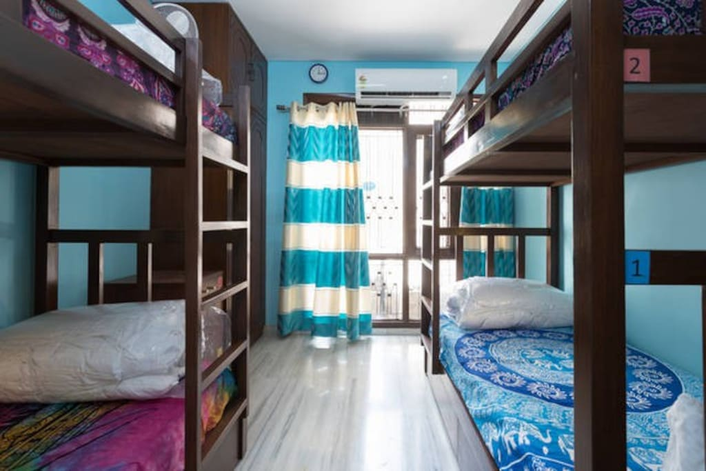 Colourful Bunk Bed Dorm with reading Lights