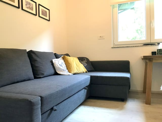 Bed for two persons is situated on a comfortable sofa bed in the common area. Bed linen is included in the offer.