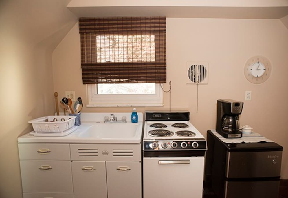 Small kitchen with microwave, fridge, toaster oven and coffee maker. The stove had to be removed due to a borough ordinance.
