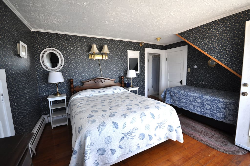 Room # 1 queen bed and a trundle bed