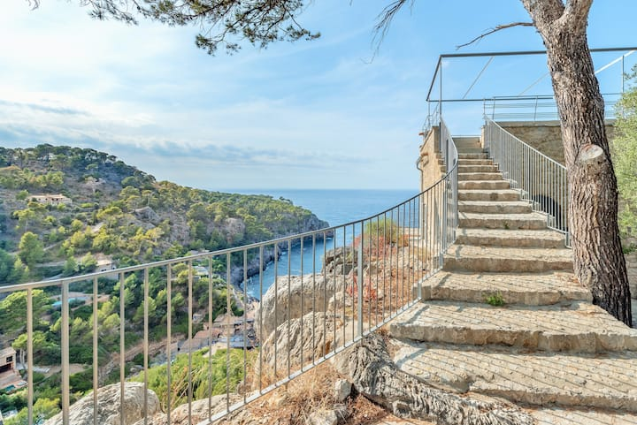 Deia tower overlooking the sea and its iconic cove