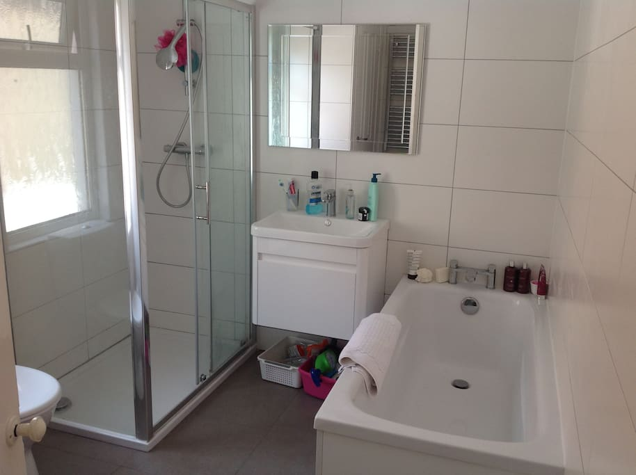 Shared bathroom with separate shower and toilet