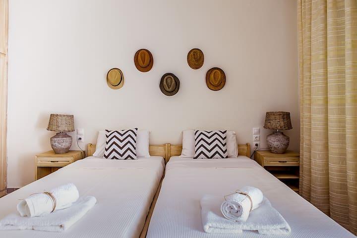 Bedroom offering 3 single beds.