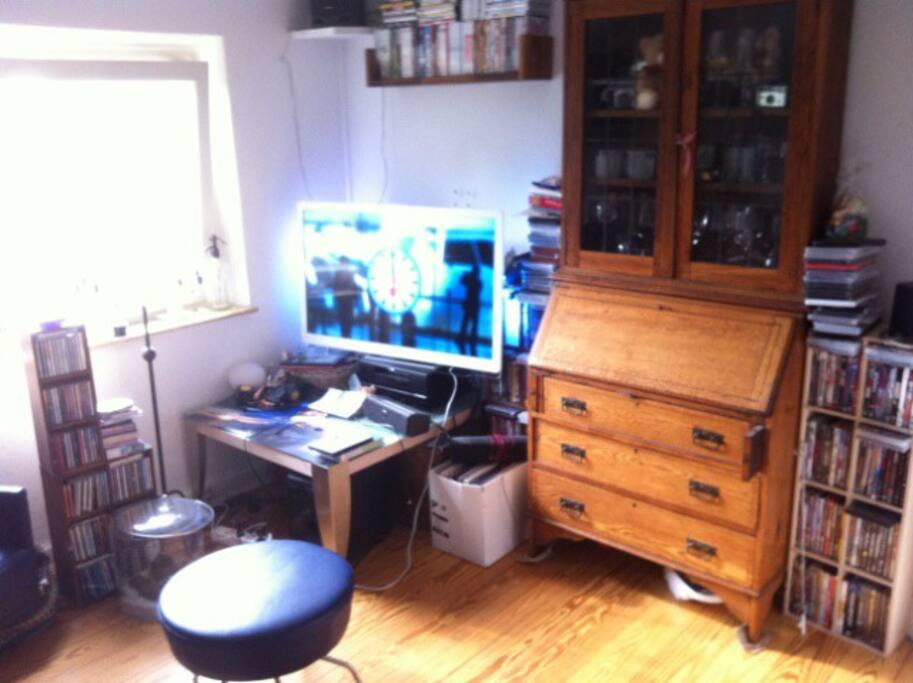 Living room with old furniture and brand new tv and around 600 dvd`s to discover