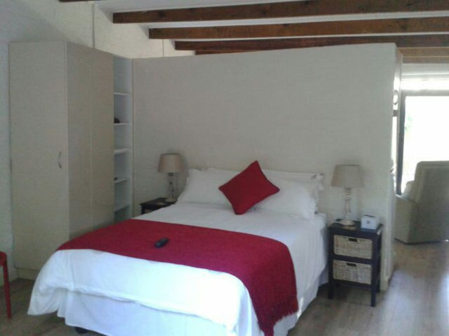 Double bed separate from living area