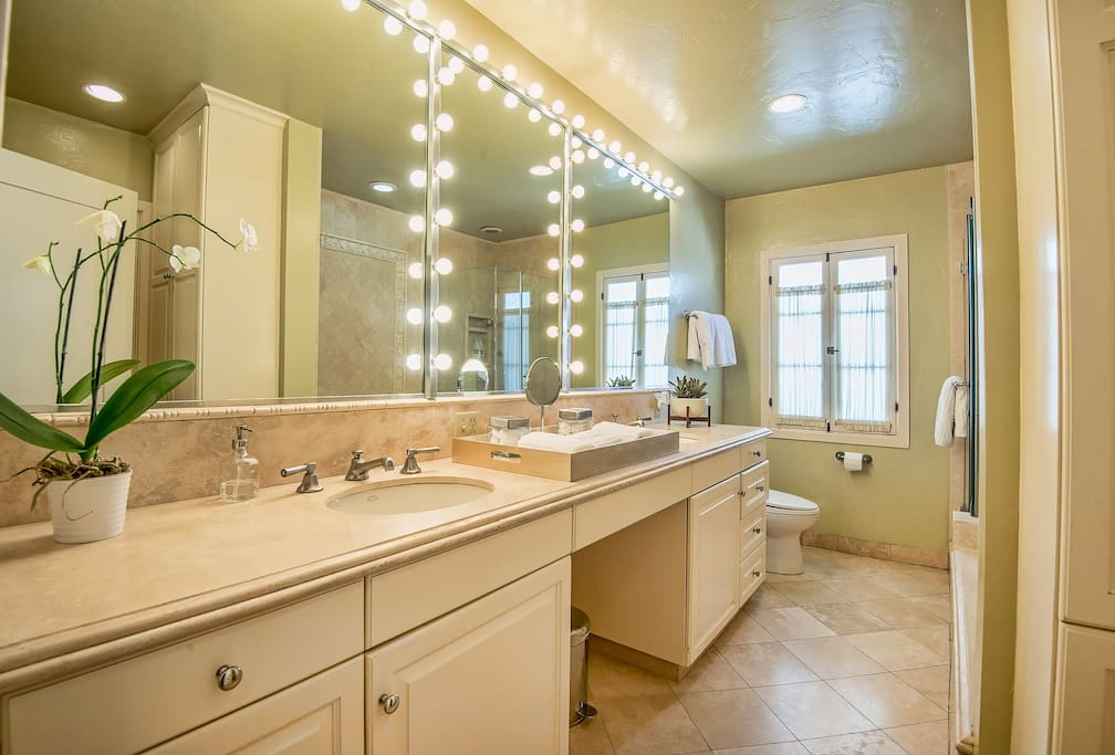 "Stunning private bathroom with ""Glamour"" lighting"