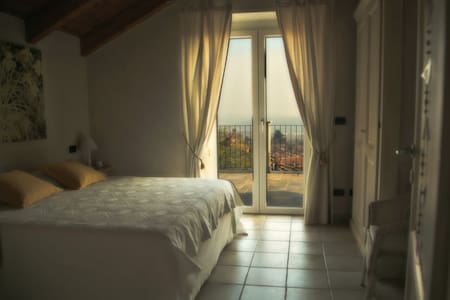 Camera con vista Lago - Candia Canavese - Bed & Breakfast