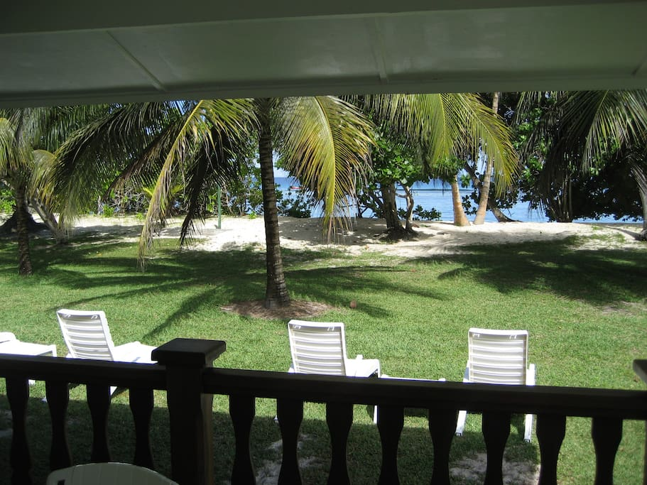 Veranda view over the private landscaped garden to the beach of Anse Forbans