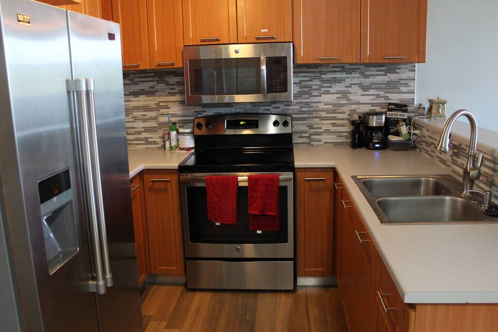 Kitchen with all the amenities, including coffee maker and grinder.