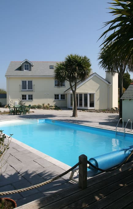 Rainbows End Cottage can be seen on the left overlooking the private, heated swimming pool.
