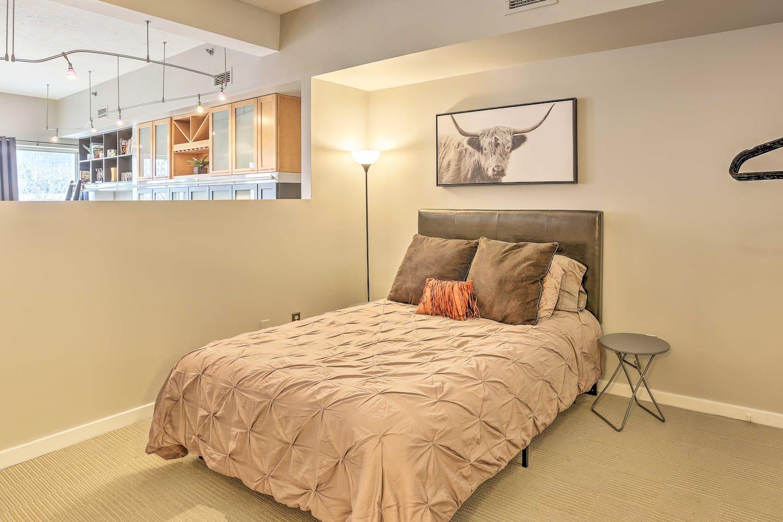 The bedroom features a queen bed.