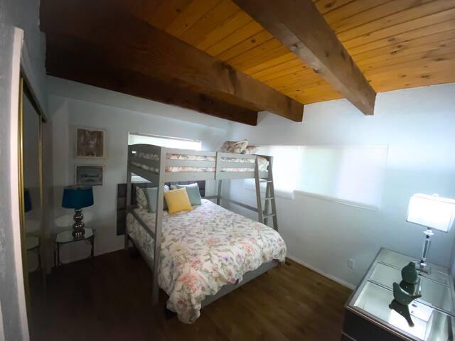 Main floor Bedroom No 2.  Queen bed. Full Loft. Fire/Alexa TV. Netflix